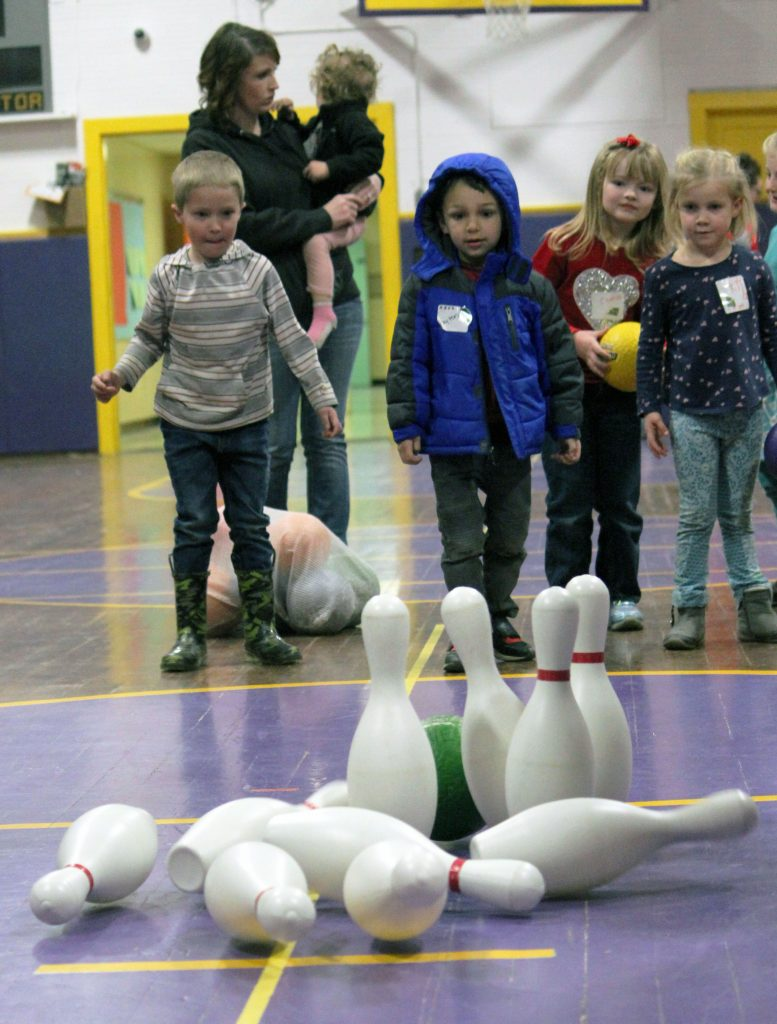 children bowling to learn about playing