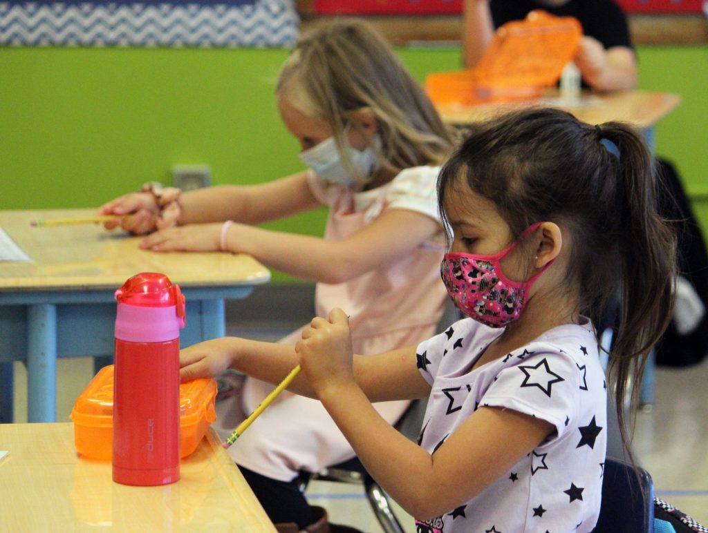 Kindergarteners in Amber Mc Donald's class at Peterson Elementary School take out their pencils.