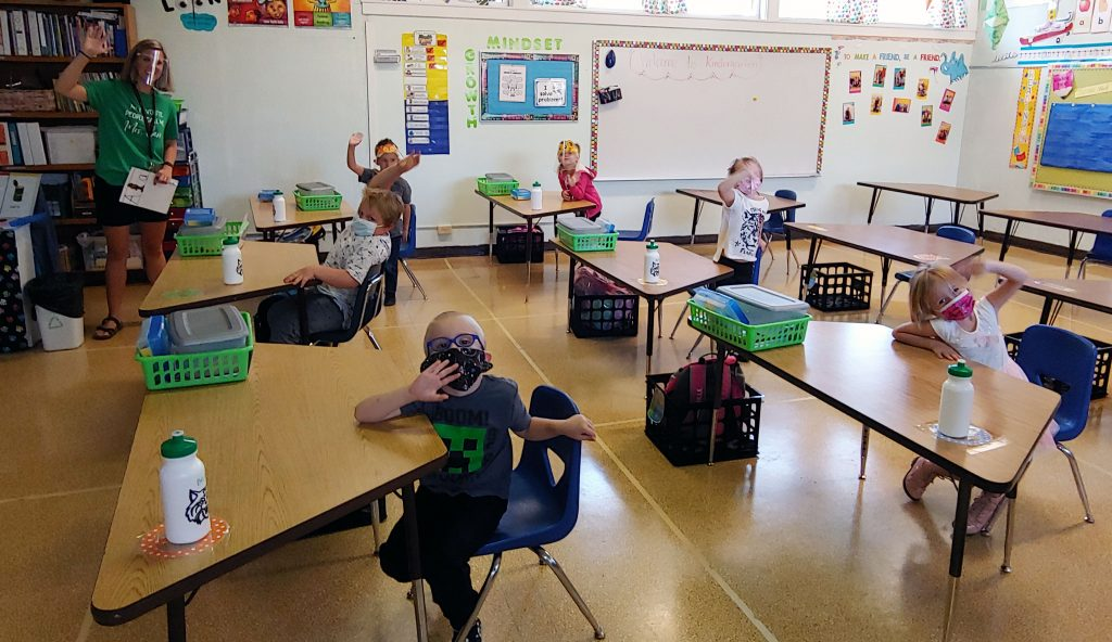 Brittany Carr's kindergarten A-cohort at Stearns Elementary School waves to the camera on the first day of school.