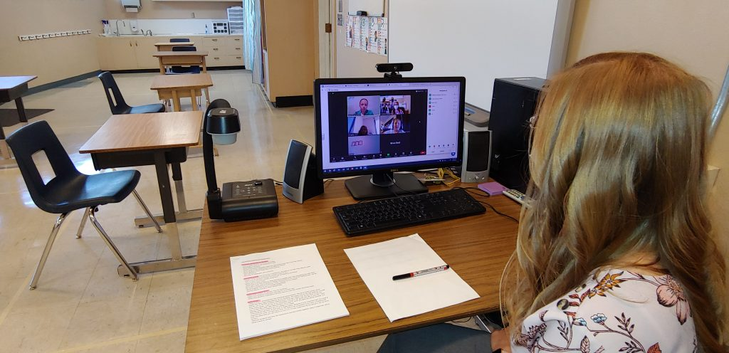 Stearns Elementary School fifth-grade teacher Brittany Rodriguez teaches her class live online during the first day of school.